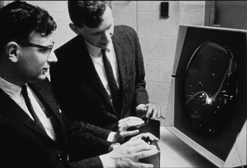 Dan Edwards (left) and Peter Samson playing Spacewar! on the PDP-1 Type 30 display (Source:  Computer History Museum)
